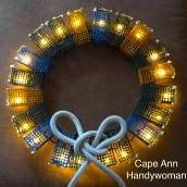 Lobster Trap Wreath colored with white bow and lights